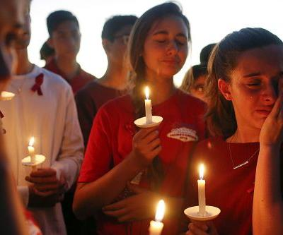 Hundreds hold vigil for victims of Florida school shooting
