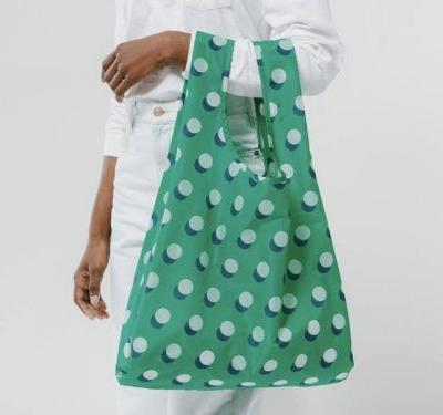 People are obsessed with this $10 reusable nylon tote that can hold 50 pounds of stuff and fits in your back pocket