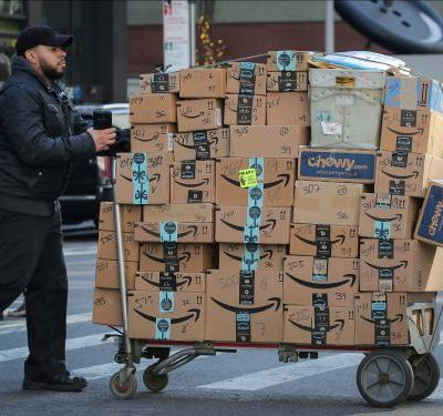 Mail carriers and police departments across the US are bracing for record-high package deliveries this holiday season as Walmart and Amazon offer cheaper, faster shipping than ever before