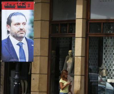 France says Hariri accepts invitation, will come within days