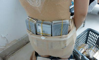 Woman caught with 102 iPhones strapped to her body in brazen smuggling attempt