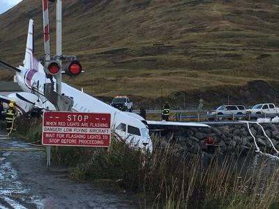 One person died after a plane overshot the runway at an Alaskan airport and crashed into a river