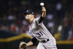 Rockies' Freeland leaves game after being struck by liner