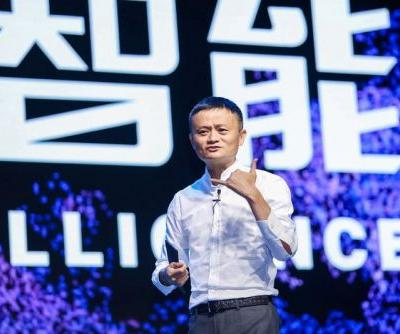 Alibaba is up after buying a big stake in China's largest grocer