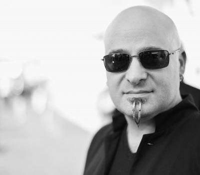 "Disturbed Singer Removes His Signature Chin Piercings: ""It Felt Weird Walking Around Like A 45-Year-Old Hot Topic Kid"""