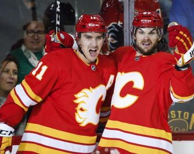 Johnny Gaudreau scores 100th goal as Flames topple Bruins