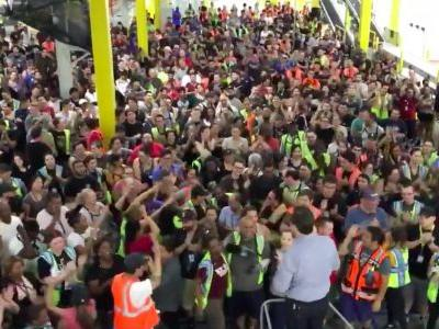Watch Amazon warehouse employees go wild as news breaks of the company's new $15 minimum wage