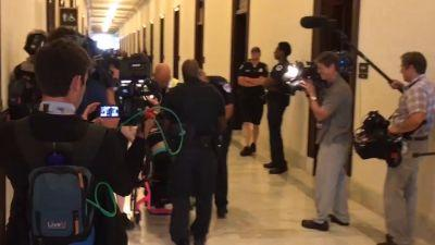 Health care replacement protester dragged out of wheel chair