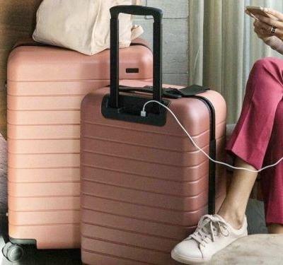 This sleek $225 carry-on suitcase can charge your phone and only weighs 7 pounds - and it's just what modern travelers need