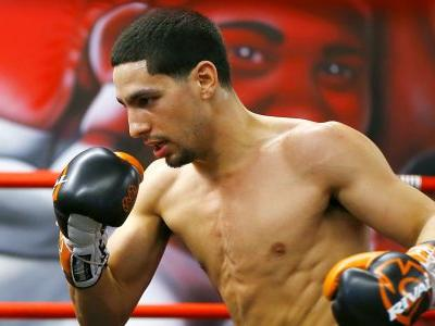 Danny Garcia fires on all cyclinders, scoring a seventh-round knockout over Adrian Granados