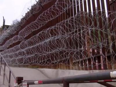 Leaders of this city on Southern border want wall's razor wire removed or they'll sue