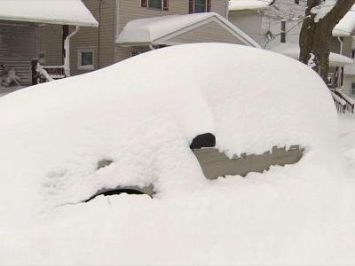 Erie smashes snowfall record with flakes still falling