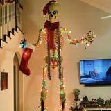 People Are Using Their Massive Home Depot Halloween Skeletons in Their Holiday Decor, and LOL