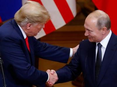 Trump says he doesn't 'see any reason' why Russia would have hacked the US election when asked whether he believes Putin or the US intel community
