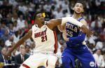 Philadelphia 76ers wrestle home playoff victory from Miami Heat