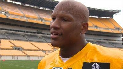 Ryan Shazier shown waving Terrible Towel, cheering on Steelers from private box during game vs. Patriots