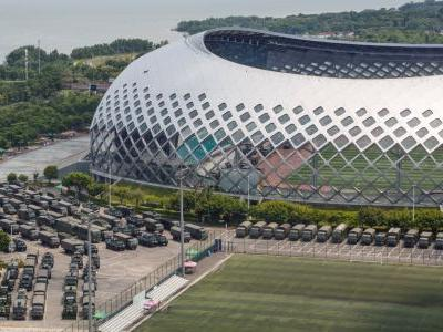 Chinese armed police are drilling at a stadium outside Hong Kong in a 'clear warning' to protesters