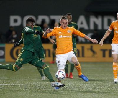 Dynamo beat Timbers 2-1 to advance in the MLS playoffs