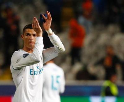 Real Madrid cruise into last 16, Liverpool blow three-goal lead