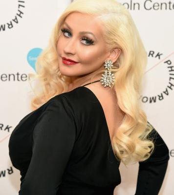"Christina Aguilera Admits She's Been Putting Herself on ""the Back Burner"" For Her Kids' Sake"