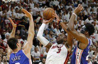 Not done: Wade decides to keep playing, will return to Heat