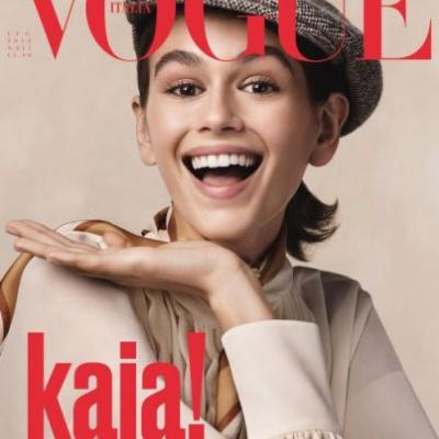 Kaia beams on the cover of Vogue Italia's July issue