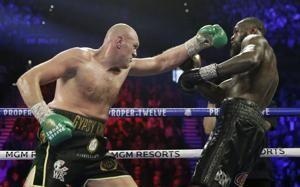 Fury wins in stunning stoppage of Wilder in heavyweight tilt
