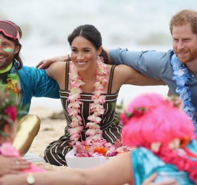 Prince Harry and Meghan Markle ditched royal etiquette to go barefoot on the beach and join an 'anti-bad vibe circle' with surfers