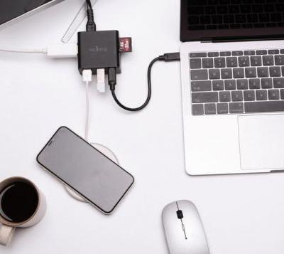 Nestling MacBook power adapter and USB-C hub