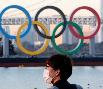 Japan PM determined to hold Olympics, will cooperate with Tokyo and IOC