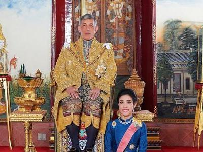 The King of Thailand abruptly stripped all royal titles from his 34-year-old consort, who is accused of plotting against the queen to take her place
