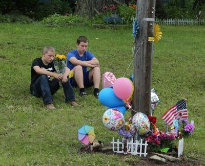 Memorial rises in Coventry Township where two girls were hit, killed by car; boy remains in critical condition