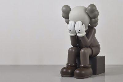 "A Rare KAWS ""Seated Companion"" Gets Auctioned off for $411,000 USD"