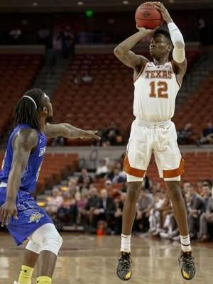 Osetkowski leads Texas over S. Dakota St. 79-73 in NIT
