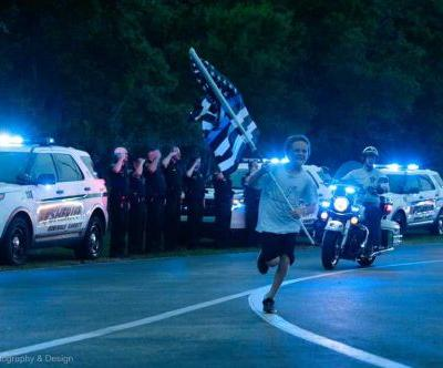 Surrounded by law enforcement, 10-year-old boy runs to honor fallen officers