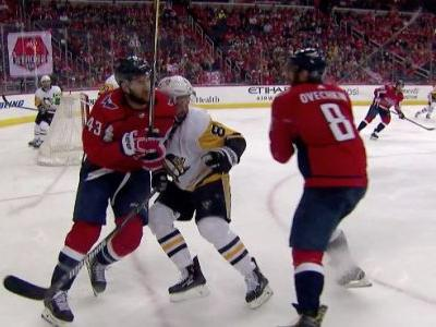 Penguins' Dumoulin injured by hit to head from Tom Wilson
