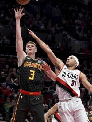 McCollum has triple-double, Trail Blazers beat Hawks 120-111