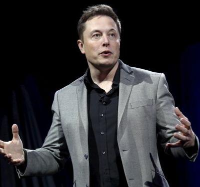 Elon Musk said he expects Tesla to deliver around 50% more cars than last year, even if there's a global recession