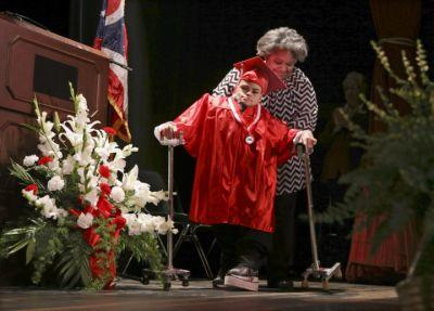 Student with spina bifida takes the longest walk of his life across graduation stage