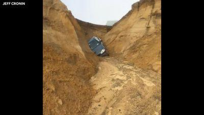 Car swallowed when Beachcomber lot collapses