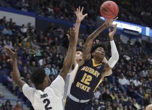 Morant's triple-double leads Murray St upset over Marquette