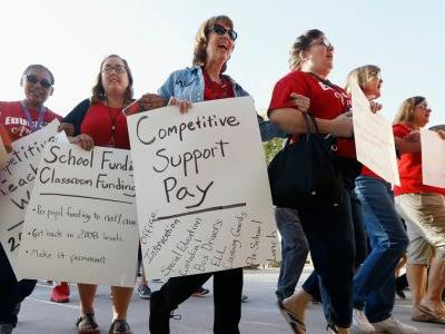Arizona teachers weighing whether to walk out in protest