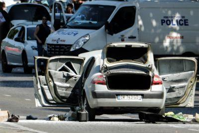 Car that plowed into police van in Paris was loaded gas canisters and guns