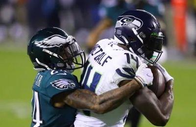Metcalf, Wilson lead Seahawks past Eagles to top NFC West