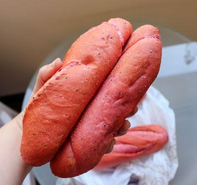People in Vietnam are flocking to a bakery that sells pink bread invented to use up the tons of dragon fruit going unsold because of the coronavirus outbreak