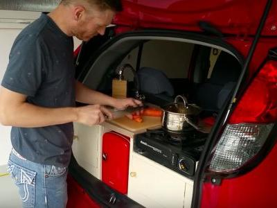 DIY Hero Builds Fully Functioning Kitchen In The Back Of A Tiny Electric Car