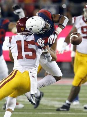 Ware runs for 2 TDs, USC holds off Arizona 24-20