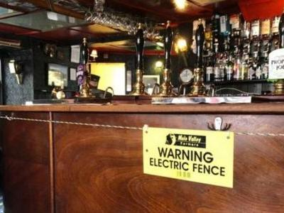 English Pub Installs an Electric Fence to Maintain Social Distancing