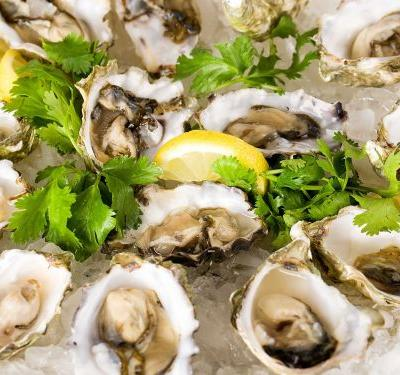 A woman reportedly died of flesh-eating bacteria after eating raw oysters - here's how concerned you should be