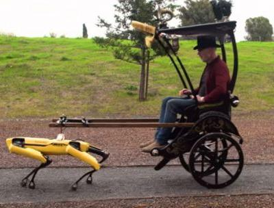 Watch Boston Dynamics' robot dog Spot haul Adam Savage in a rickshaw